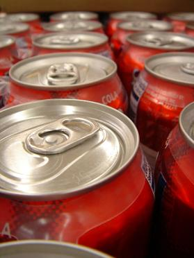A large pack of soda cans that damage your teeth enamel.